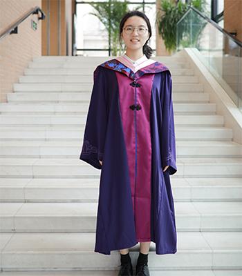 Nianpo Su in graduation regalia, smilling