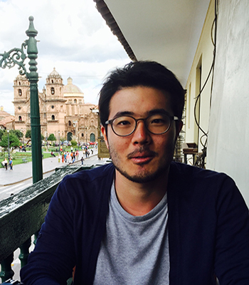 Young-Hoon Kim sitting with cathedral in background