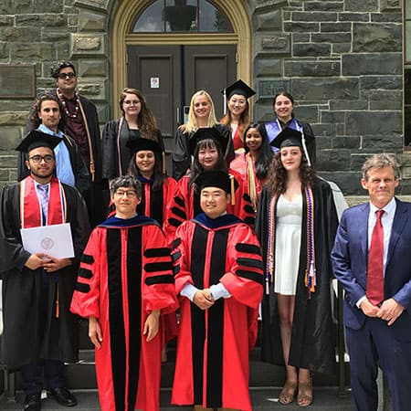 2019 Linguistics graduates pose on steps of Morrill Hall