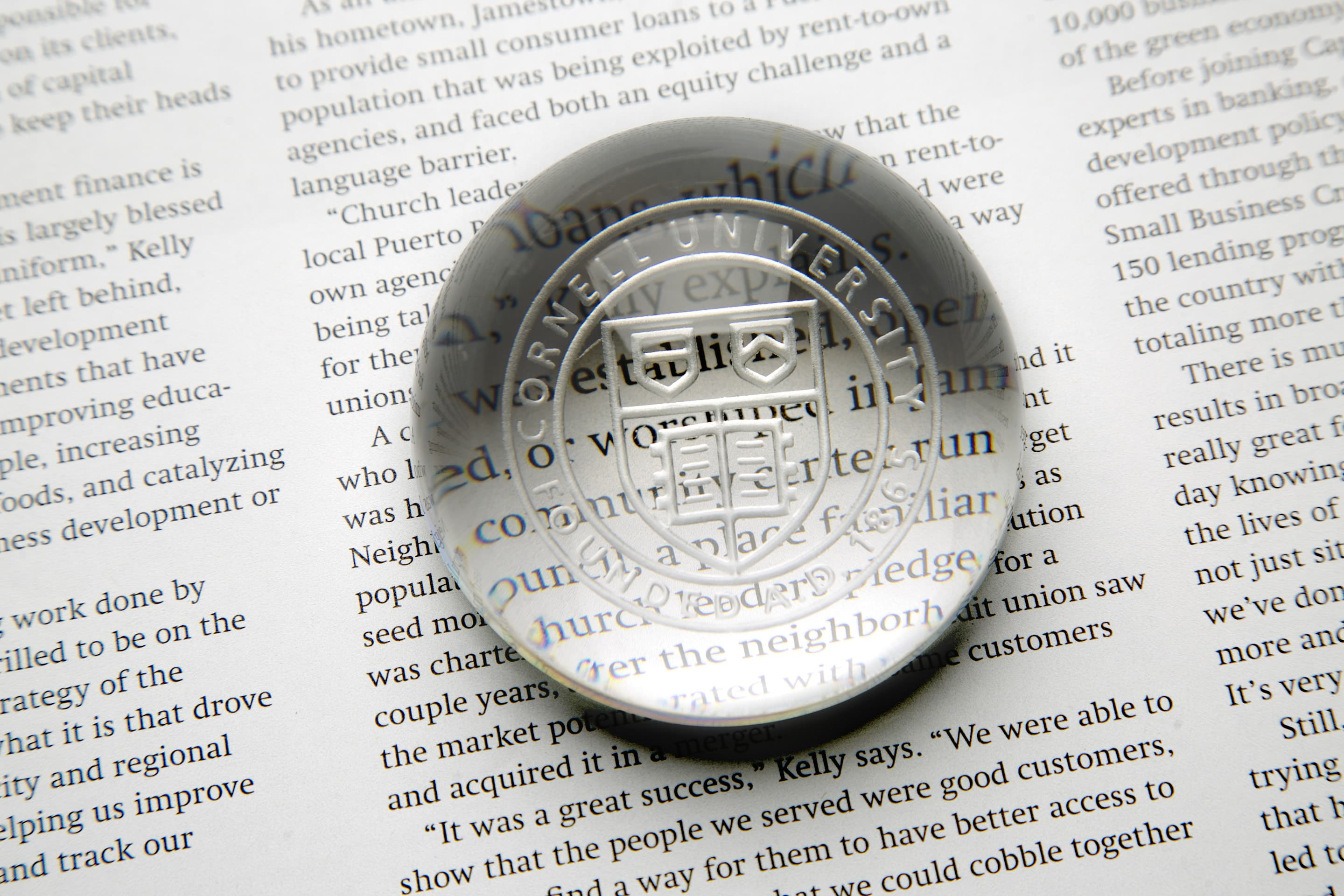 Cornell seal with book text in the background