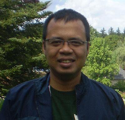 Okki Kurniawan with trees in background