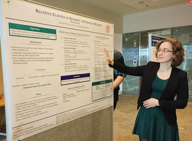Mary Moroney presenting a poster with her research