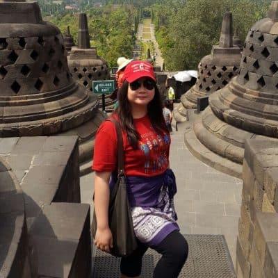 Rina Winarto standing in stone temple