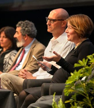 Sarah Murray and other faculty seated in a panel discussion