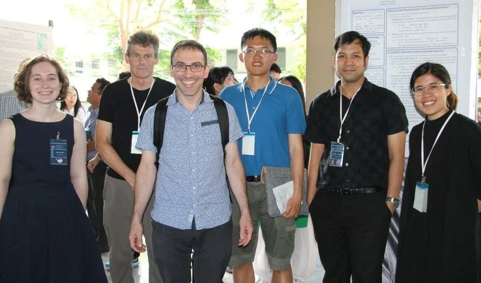 Students and faculty posing at a conference